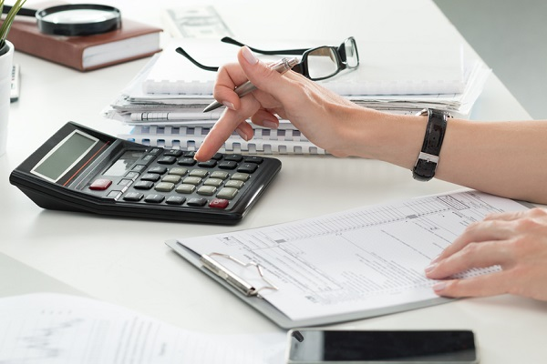Bookkeeper using calculator