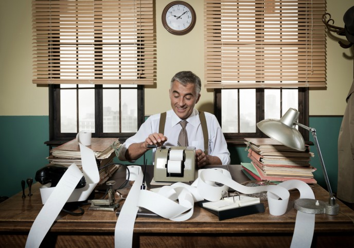 The evolution of bookkeeping - image of bookkeeper at desk